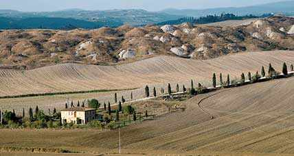 A motorcycle ride in the singular Crete of Siena, Tuscany